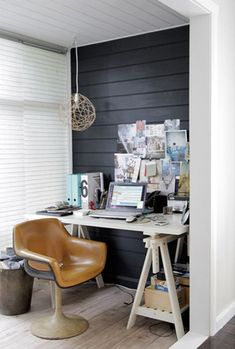 Little nooks as offices or meeting rooms. Like the one dark wall. And LOVE the chair.