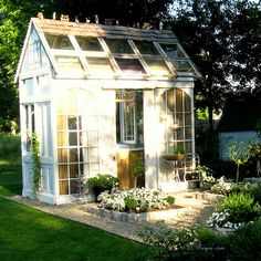 Greenhouse, love the recycled arched windows.