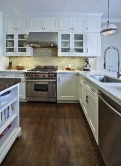 stained oak floor. nice backsplash too. uneven glass cabinets.