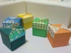 Caixinhas em origami, feitas com papel de origami especial de bolinhas, xadrez, flores e papel liso. Série feita para lembrancinha de maternidade da minha filhinha Alice. Contém um bombom de licor e por cima o nome feito com a técnica de Kirie.  Contato: 11 2772.9242 ou 11 8127.0390  Elisa Grec