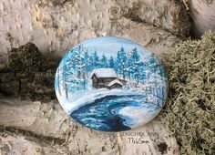 Beautiful winter scene rock painting!