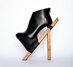 """By Moksha. Moksha started off making a shoe and then just said """"fuck it"""" and hammered a couple of sticks to the bottom instead."""
