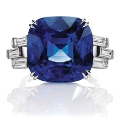 The remarkable Sunset by Harry Winston Ring features a 18.51 carat cushion-cut sapphire and 6 baguette diamonds totaling 1.25 carats. #harrywinston #diamond #sapphire #ring