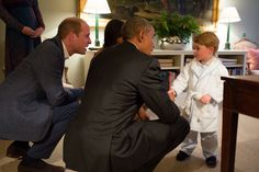 President Barack Obama with First Lady Michelle Obama meets Prince George as the Duke and Duchess of Cambridge watch at Kensington Palace in London, April 22, 2016.