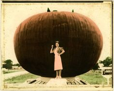 Tomato festival, June Garland standing by big tomato.  Photographer: Luther M. Hamilton, Sr.  1938  Crystal Springs, Mississippi  Copiah County