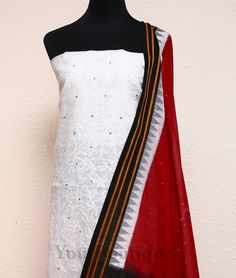 AT036-5 Cream colour kota material with dazzling mirror work. Black cotton bottom. Black and maroon ikkat printed cotton dupatta with woven borders.