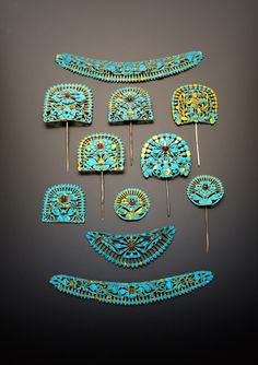 ELEVEN CHINESE GILT METAL AND KINGFISHER FEATHER HAIR ORNAMENTS QING DYNASTY Variously decorated with scrolling foliate designs, bats and butterflies and set with coloured stones, one depicting a standing figure, 22.7cm max. (11) Provenance: a private collection, London.