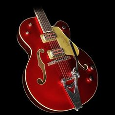 """Gretsch Limited Edition G6120T-59CAR Nashville with Bigsby This limited edition Gretsch hot-rods the classic Nashville with a killer Candy Apple Red finish with matching TV Jones Classic pickups. The guitar has a laminate maple body with a matching headstock, trestle bracing, and """"Squeezebox"""" paper-in-oil capacitors under the hood for even smoother vintage tone. Includes: Hardshell Case and... $ 2,799.99Electric Guitar Candy Apple Red"""
