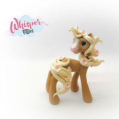 Whisper Fillies Sakura cherry blossom Palomino horse pony figurine. Handmade from Polymer Clay Visit my etsy page whisperfillies.etsy.com for more little Filly cuteness.