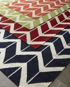 Chevron rugs in orange, lime, red, navy.  Rugs that are the center of the room! Free shipping!