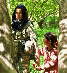 Female American soldier and Afghan girl