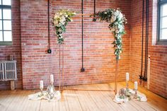 Copper wedding arbour with white flowers and lush greenery for a Calgary, Alberta wedding at Charbar. Photo: @cor