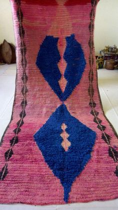 "***Moroccan vintage rug*** hande made by moroccan rug materials : wool,cotton size : 222x103 cm colors : red,pink,blue please see pics for exact colors If you have any questions regarding this item, please hit the ""Ask a Question"" button next to the price and I will get back to"