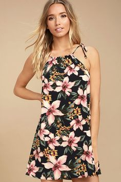 The Hawaiian Haven Navy Blue Floral Print Shift Dress is your own little piece of paradise! Silky woven fabric, with a pink, orange, and green floral print, falls from tying straps and a drawstring neckline into a breezy shift bodice.