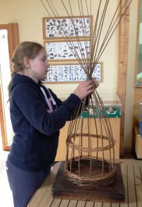 a wooden base is used to hold the spokes for weaving