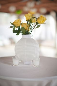 flip over a plain white lantern and add a few roses for a super simple (and affordable) centerpiece
