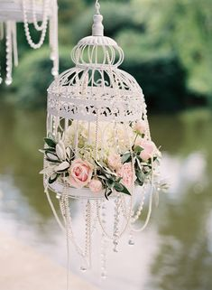 shabby chic birdcage and flowers. Cute. I would do an antique gold finish with burgundy/ dark red flowers