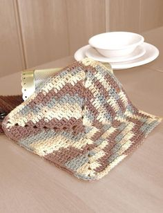"Made in the style of a simple granny square, this free crochet pattern from <a href=""http://www.favecrafts.com/Craft-Manufacturers/Lily-Sugar-n-Cream"" target=""_blank"" title=""Lily Sugar n' Cream"">Lily Sugar n' Cream</a> for dish cloth is perfect for beginners. The ombre yarn provides the variation in color without switching balls. If you've never crocheted a dishcloth before, you absolutely must try this Easy Ombre Dishcloth Crochet Pattern. Ombre is s..."