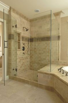 another example of shower bench joining tub surround. note the tile accent in the shower and unifying base tile trim