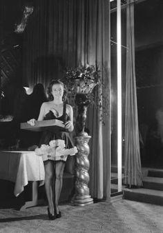 A cigarette girl at Ciro's, Los Angeles. 1940s