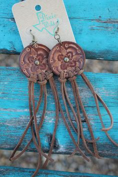 Handmade, hand-cut and hand-tooled from veg tan 3/4 oz. leather. Our jewelry is made to look like a vintage heirloom piece, something passed down and well-worn with a western/boho/gypsy flair. We hand make all of our jewelry so there will be slight imperfections and all are one of a