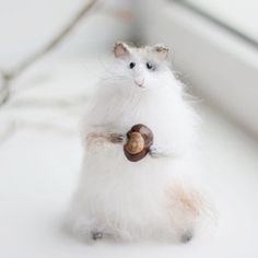 White hamster with chestnut. Hamster hand-knitted from high-quality mohair yarn. Filled eco-friendly polyester fiber. Mobile hands and legs. A inside wire. His face and feet embroidered. 🌿🌿🌿 Хомячок с каштаном, он из давних моих работ,  из любимых)