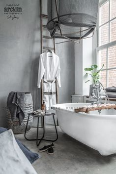 lovely bathroom with concrete floor, Photography by Paulina Arcklin for UNO Image
