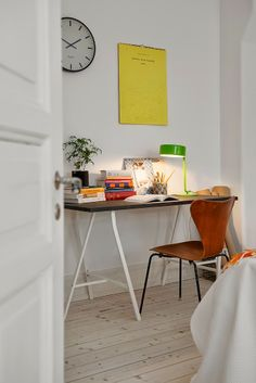 A touch of colour in a light and airy Swedish home. Alvhem.