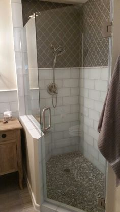 Frameless shower on an angle by The Glass Guru of Peoria.