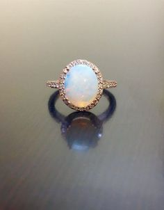 18K Rose Gold Halo Diamond Opal Engagement Ring   by DeKaraDesigns  Dear future husband.....