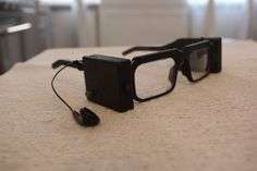 Parsee printed smart glasses help the blind to identify objects, text, faces, colors 3d Printing Business, 3d Printing Service, Free Glasses, Smart Glass, Sling Tv, Pbs Kids, Security Camera System, Wearable Device, Ip Camera