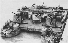 "German ferry artillery support Siebel  A German ferry artillery support ""Siebel"" at anchor carrying four 88 mm Flak 36 anti-aircraft and two 20 mm FlaK 38 anti-aircraft guns."