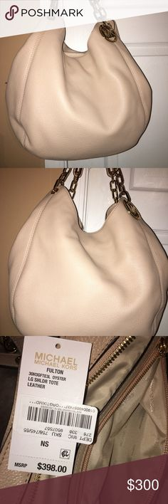 Michael Kors bag NWT, Oyster Gorgeous Michael Kors bag in Oyster and beautiful Gold details. NWT. Plenty of storage Michael Kors Bags Shoulder Bags