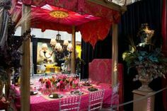 At Diffa's Dining by Design event in New York, Croscill's table resembled a canopy bed. It was covered in a bright pink quilted tablecloth and surrounded by clear Chiavari chairs.