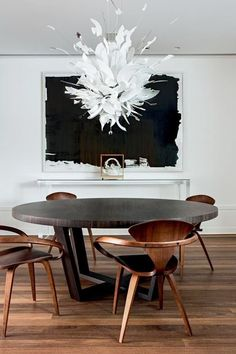 Abstract art in dining room. #modern #black #white #painting #table #chair #wood #floor #chandelier #lamp #interior #decor #decoration