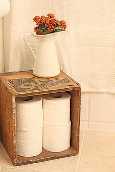 Less is more with this sweetly simple toilet paper storage in a vintage crate.