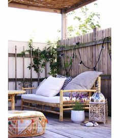 Comfortable Terrace Design Ideas With Bamboo Sofa Materials And White Bolster White And Blue Cushions Laminated Wooden Floor