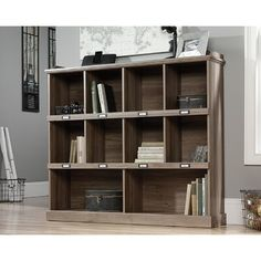 Barrister Lane Bookcase in Salt Oak - Sauder 414726414726 Features: Looking to add some extra storage to your home? Check out this bookcase from the Barrister Lane collection It features cubbyhole storage so you can store books, bins, collectibles and mor Cube Unit, Book Nooks, New Wall, Cubbies, Wood Shelves, Glass Shelves, Engineered Wood, Adjustable Shelving, Ideal Home