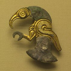 Anglo-Saxon shield ornament from Sturry, Kent, England.    Sixth Century AD, the design shows an eagle or raven.    From the collection of the British Museum, London, England.