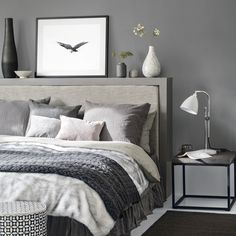 Dark grey bedroom with cosy bed linen and bedside table
