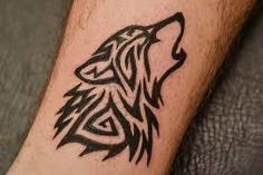 Image result for tribal wolf and arrow tattoo