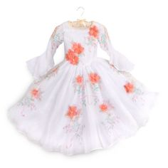 La tua bimba sarà una vera principessa delle fiabe con questo abito bianco floreale di Belle. Ispirato al film live action La bella e la bestia, l'abito presenta piacevoli dettagli come maniche trasparenti, paillette, fiori 3D e gonna lunga fino ai piedi.