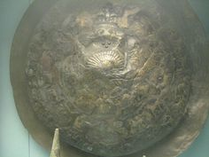 Urartian inscribed bronze shield with incised decoration.