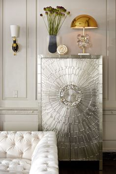 Add exotica with touches of abalone, like the handles of the Jonathan Adler Talitha Armoire.