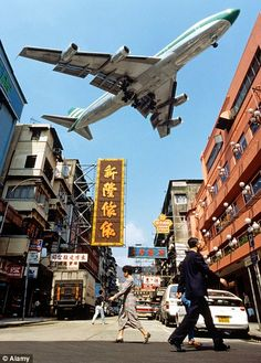 Kai Tak Airport, Hong Kong: With a perilous runway that jutted out into the sea, and an alarmingly steep descent through skyscrapers