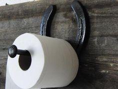 Horseshoe toilet paper holder! What a unique touch.