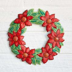 """Artisans in Haiti hand cut and paint recycled oil drums to create this incredible work of art. Comes with attached ring-style wall hanger. Dimensions: 15""""dia. Poinsettia Wreath, Floral Wreath, Paint Recycling, Haitian Art, Metal Drum, Oil Drum, Green Gifts, Wall Hanger, Fashion Rings"""