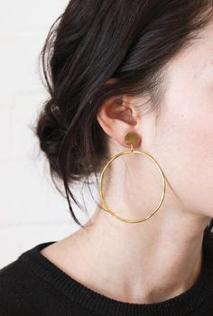 brass medallion stud with circle hoop attached. an avenue twist on the classic hoop earring. each pair will vary slightly due to their handmade nature. approx. 2.5'' top to bottom brass will age beaut