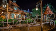 Outside Maurice's charming cottage at night at Enchanted Tales with Belle | magic kingdom