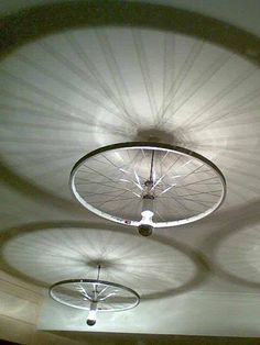 www.3LC.tv - PIC: Need some ideas on how to decorate your living room? How about bike wheel chandeliers?